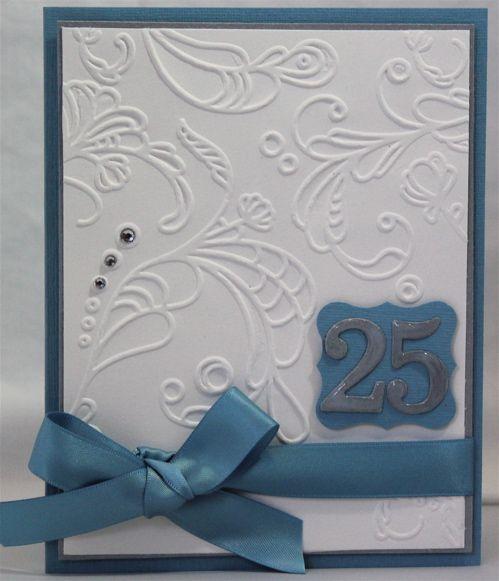 SU Elegant Lines embossing folder, Curly Label punch, Whisper White, Brushed Silver & Marina Mist CS, Marina Mist satin ribbon, Silver embossing powder, chipboard, basic jewels, Versamark, Stampin' Dimensionals and Crystal Effects (on numbers).