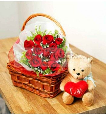 18 stem Red Roses bouquet wrapped with cellophane packing and arranged in a cane basket + Cute Teddy Bear (6 inch). #ArenaFloristMumbai