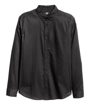 Black. Long-sleeved shirt in soft, washed cotton fabric. Button-down collar with concealed buttons. Regular fit.