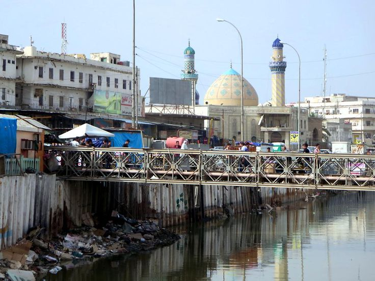 """The Imam Ali Mosque stands beside the grimy Ashar River in the center of Basra, Iraq. Once known as the """"Venice of the East"""", Basra is still reeling from the many wars fought here over the past few decades."""