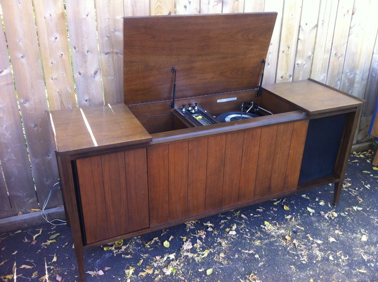 Stunning 60's Electrohome stereo turntable. Beautiful simple design. Speakers can be hidden with sliding panels.  pacificjunctionshop@gmail.com