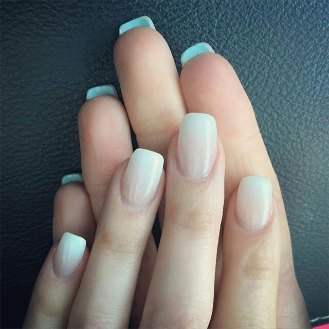 Soft white with something blue underneath nail art