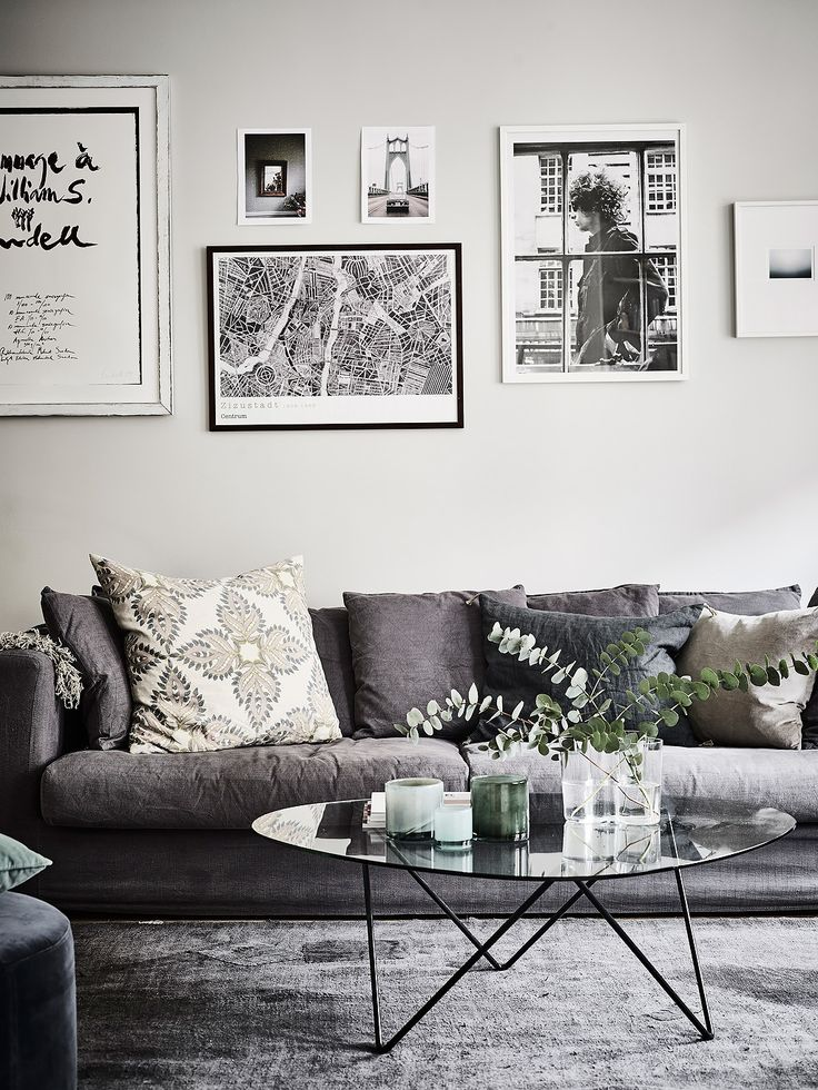 Bohemian Apartment with Floral Decor - black and white prints is a simple way to blend artwork with the decor.