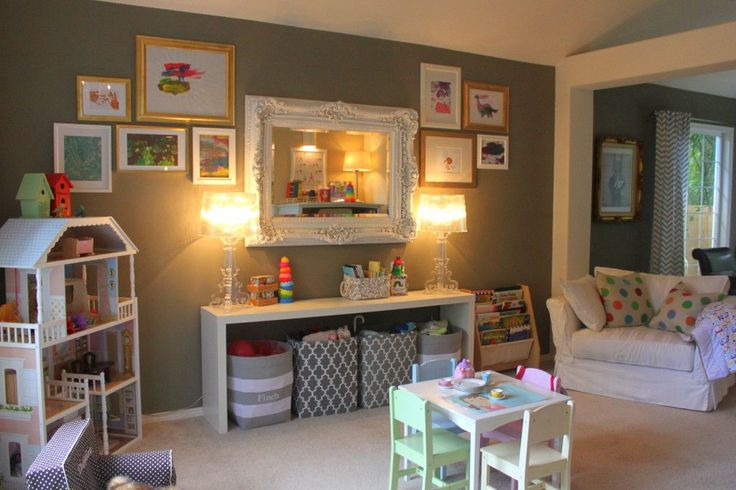 Vintage Chic Playroom - love the ornate framed mirror and fun totes for toy storage! #playroom #toystorage