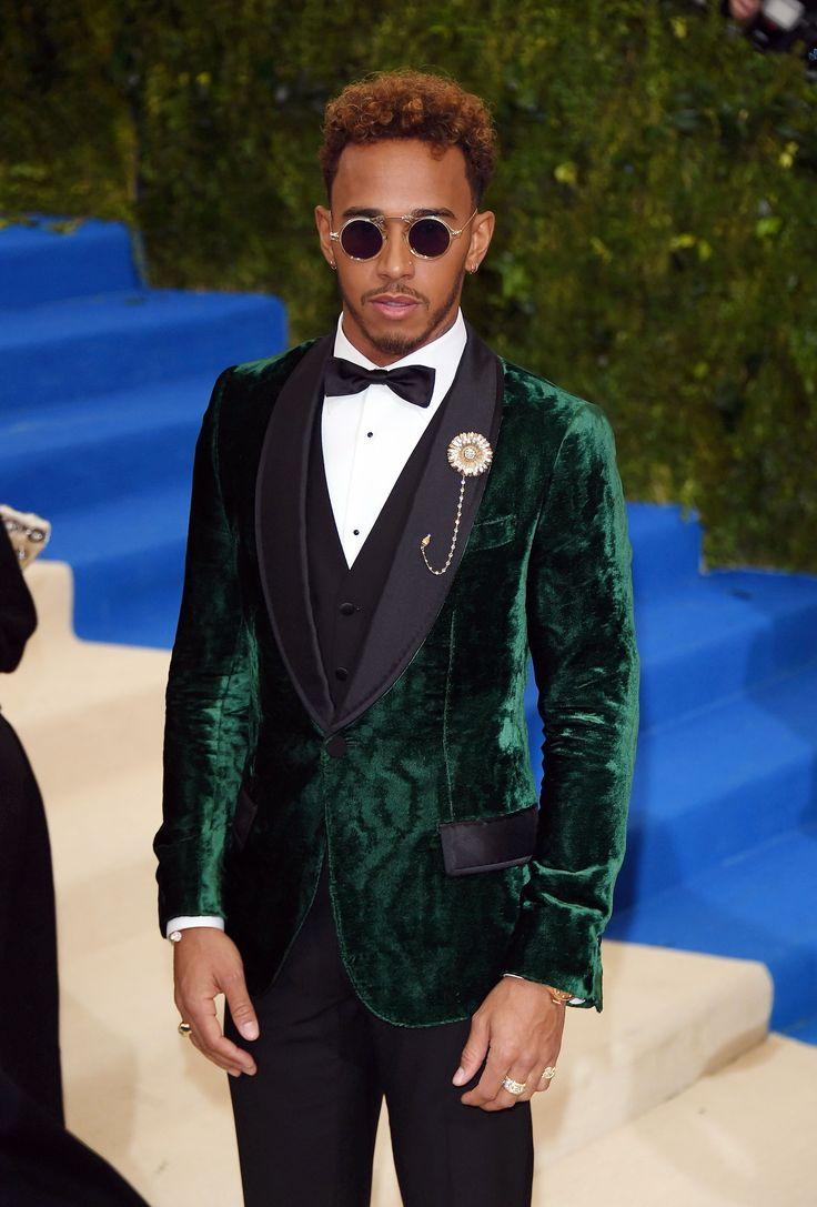 Lewis Hamilton wore a Dolce&Gabbana Alta Sartoria single breasted tuxedo in dark green moiree velvet, with black Mikado shawl collar. #MetGala #DGCelebs