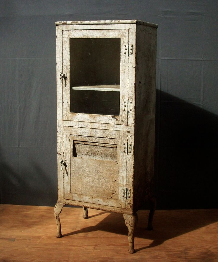 Vintage Antique Metal Medical Cabinet on Legs / Beautiful Heavily Distressed Paint and Rust / 2 Door Medical Cabinet with Glass / RESERVED by urgestudio on Etsy https://www.etsy.com/listing/250306998/vintage-antique-metal-medical-cabinet-on