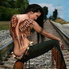 Rich red brown feather wings across back. Hot. Native spirit girl. that's a tattoo idea!