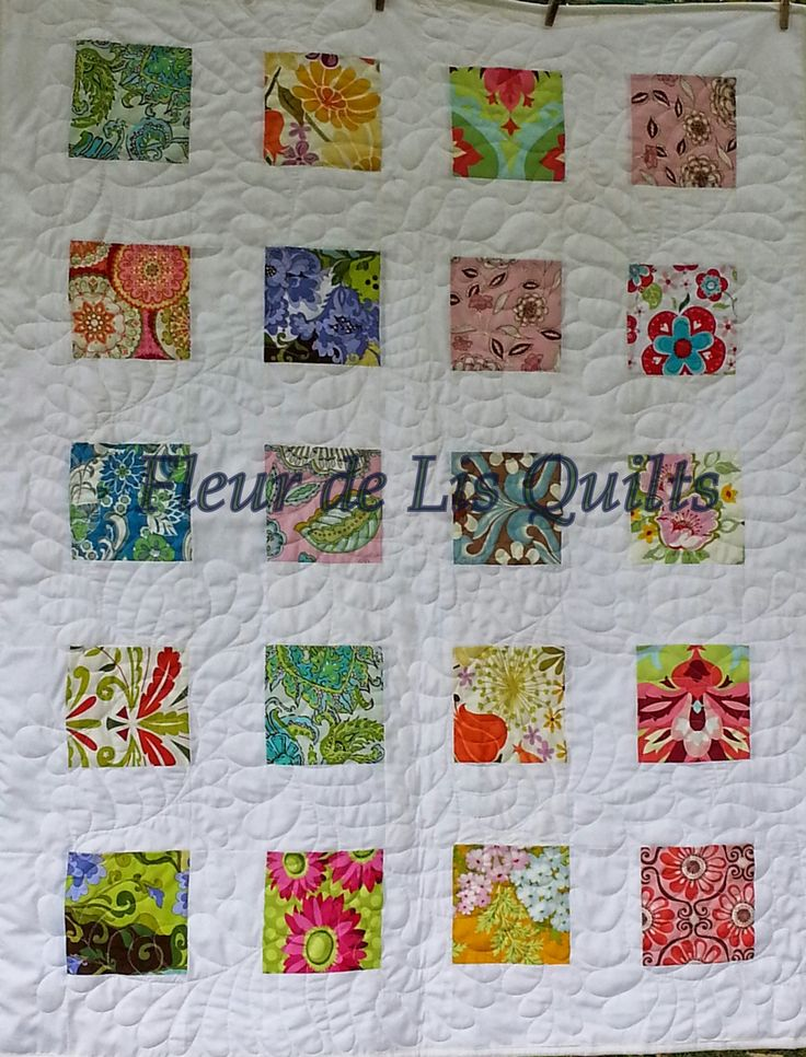 A modern quilt that shows off some pretty Lola Pink fabrics.