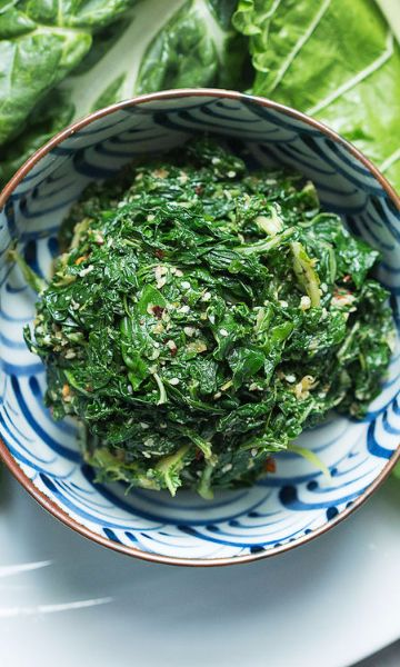 Turn tough chard leaves tender by giving them a light pounding, then dress them in this light sesame-flavored vinaigrette. It's the perfect side to Amy Thielen's Japan-meets-Midwest tonkatsu burger.