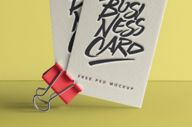 An original psd business card mockup with a paper clip to showcase your business card designs. You can change the card...