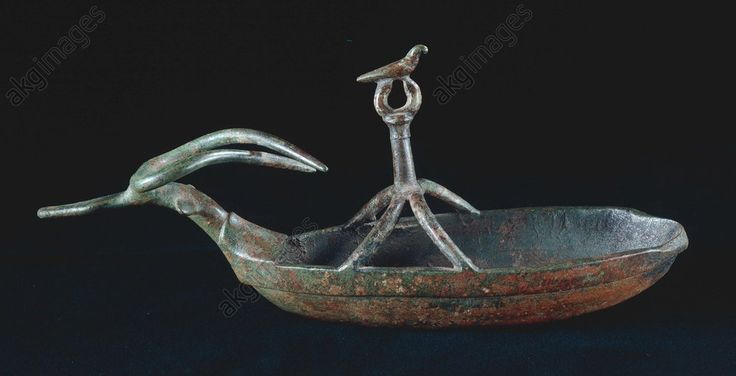 OIL LAMP / BARGE / SARDINIAN / C7TH BC. Sardinian, Nuraghian, end 7th century BC.  Oil lamp shaped like a barge.  Bronze, height 8.3cm, lenghts 21cm. Found at the Sanctuary of Gravisca. Inv. provv. II/4