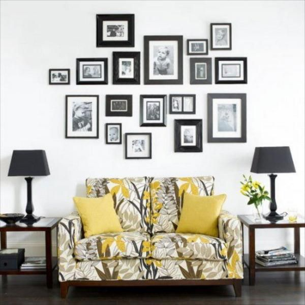 Photo Living Room Wall Collage ideas--love the different width frames and the black and white photos above a pop of color