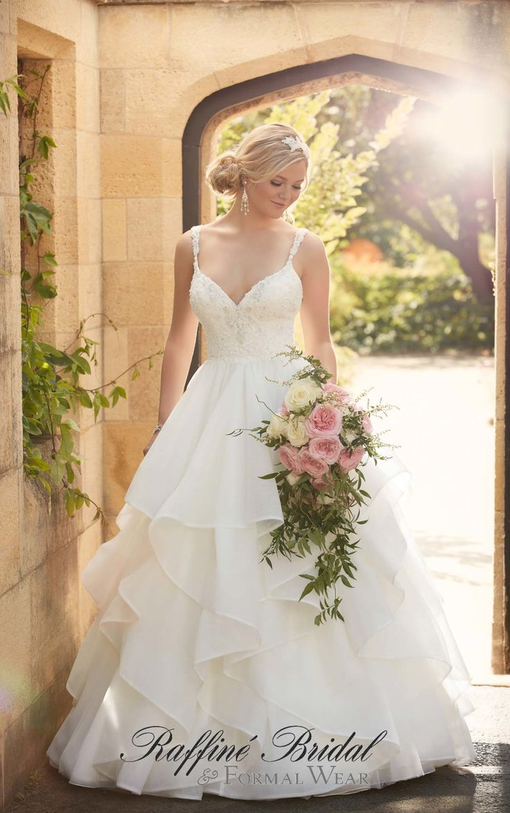 Essense of Australia #D2073 - Fit for a princess, this opulent wedding ball gown from Essense of Australia features a figure-flattering fitted bodice and shoulder straps with hand-sewn Diamante beading, and a romantic skirt of layers and layers of ethereal tulle.
