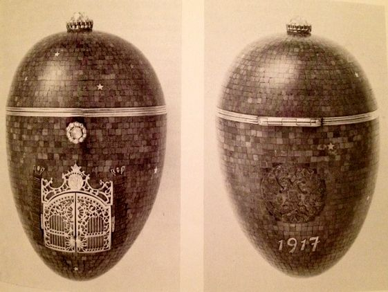 Twilight Egg (or Night Egg), dated 1917. Lapis lazuli, gold, diamonds, moonstone, paillons. Private collection. The egg is covered in a mosaic of dark blue lapis lazuli, to make it look like the night sky, with scattered gold paillon stars. In the front are two gold gates, fashioned to resemble wrought iron, opening to reveal a gold plate engraved with a garden view of Peterhof. Likely begun by Fabergé but completed elsewhere.