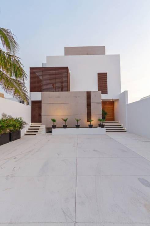 Casas de estilo minimalista de Enrique Cabrera Arquitecto