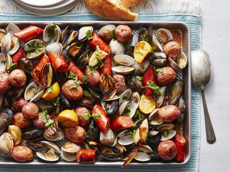 """Finally, a seafood """"bake"""" that lives up to its name. This lively platter of mussels, clams, sausage, and potatoes is a super fun..."""