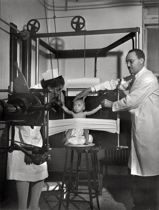 Baby getting an x ray in 1942