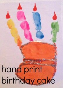 Make a hand print birthday cake design.  Is it wrong that for her first birthday i want her to do this with just get middle finger painted? (one candle for one year...right?)