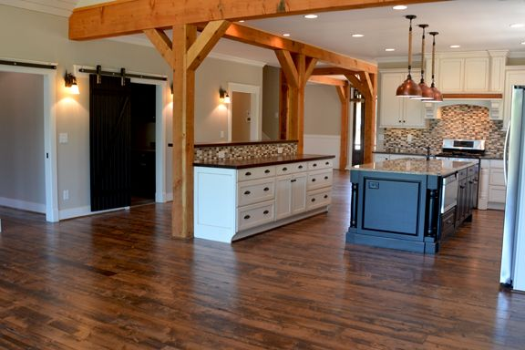 open concept kitchen  cedar posts white distressed