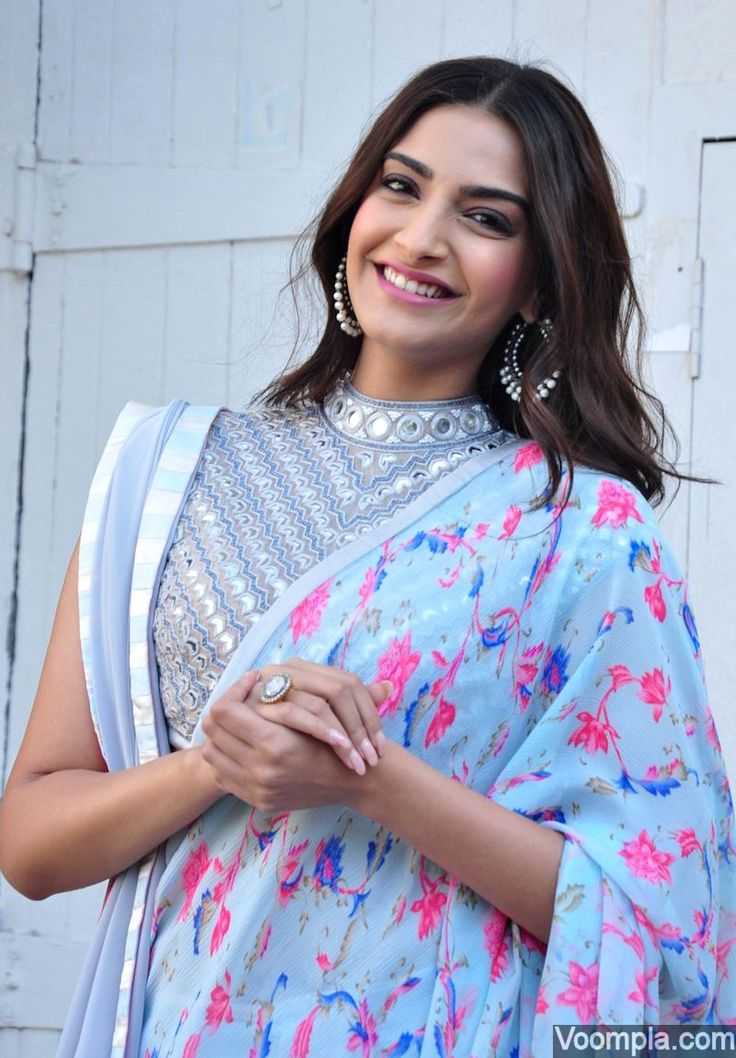 Sonam Kapoor looking gorgeous in a double pallu icy blue sari and blouse by Abu Jani Sandeep Khosla. via Voompla.com