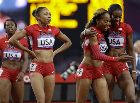 United States' women's 4 X400-meter relay team from left, Francena McCorory, Allyson Felix, Sanya Richards-Ross and Deedee Trotter celebrate after winning the gold medal during the athletics in the Olympic Stadium at the 2012 Summer Olympics, London, Saturday, Aug. 11, 2012. (AP PhotoAnja Niedringhaus)