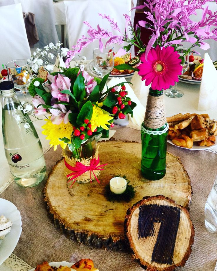 Rustic wedding centerpiece in mason jars and beer bottles by Atelier Floristic Aleksandra concept Alexandra Crisan