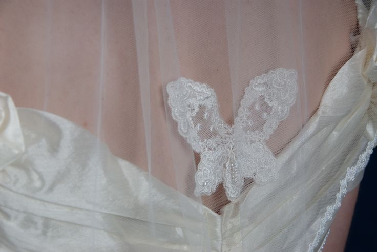 Close up butterfly detail handmade silk tulle shoulder length veil by Beautiful Unique
