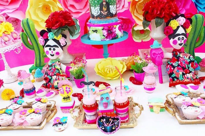 Sweets and treats adorning the cake table from Frida Kahlo Day of the Dead Inspired Fiesta at Kara's Party Ideas! See the amazing pics here