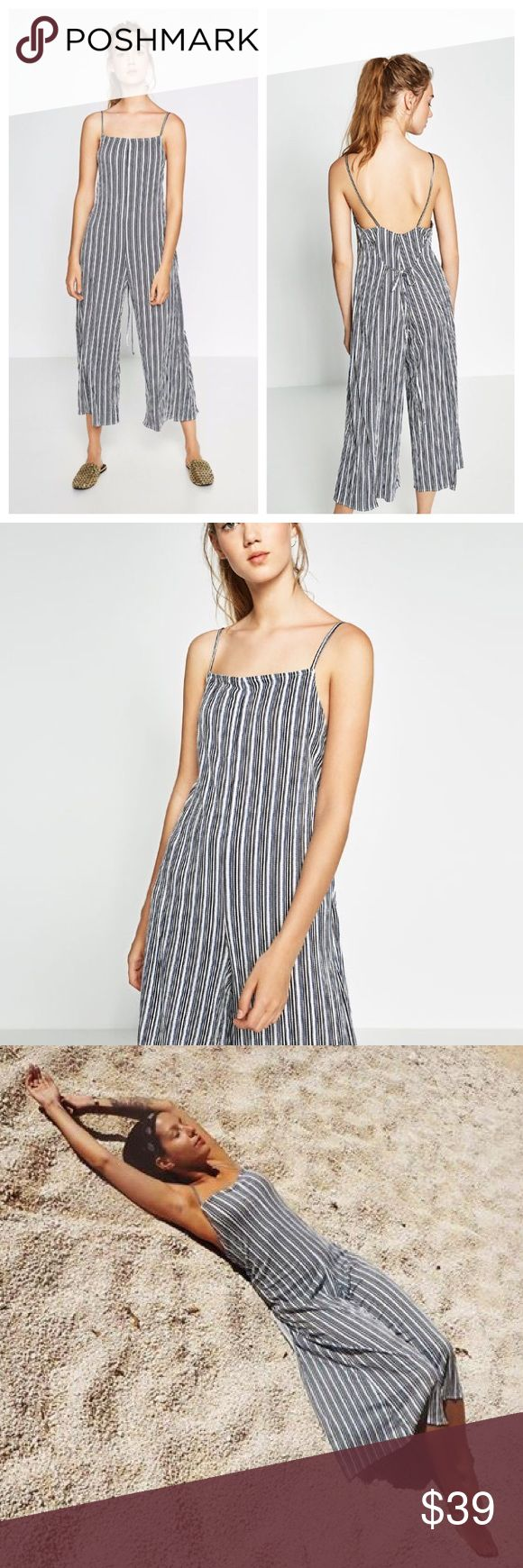 Smashing 🔥 ZARA Cropped Striped Jumpsuit Romper L So cute and versatile...and flattering and comfortable!! Can dress it up with high heeled sandals or wear to the beach with flip-flops. 96% viscose, 3% polyester, 1% elastane. Zara Pants Jumpsuits & Rompers