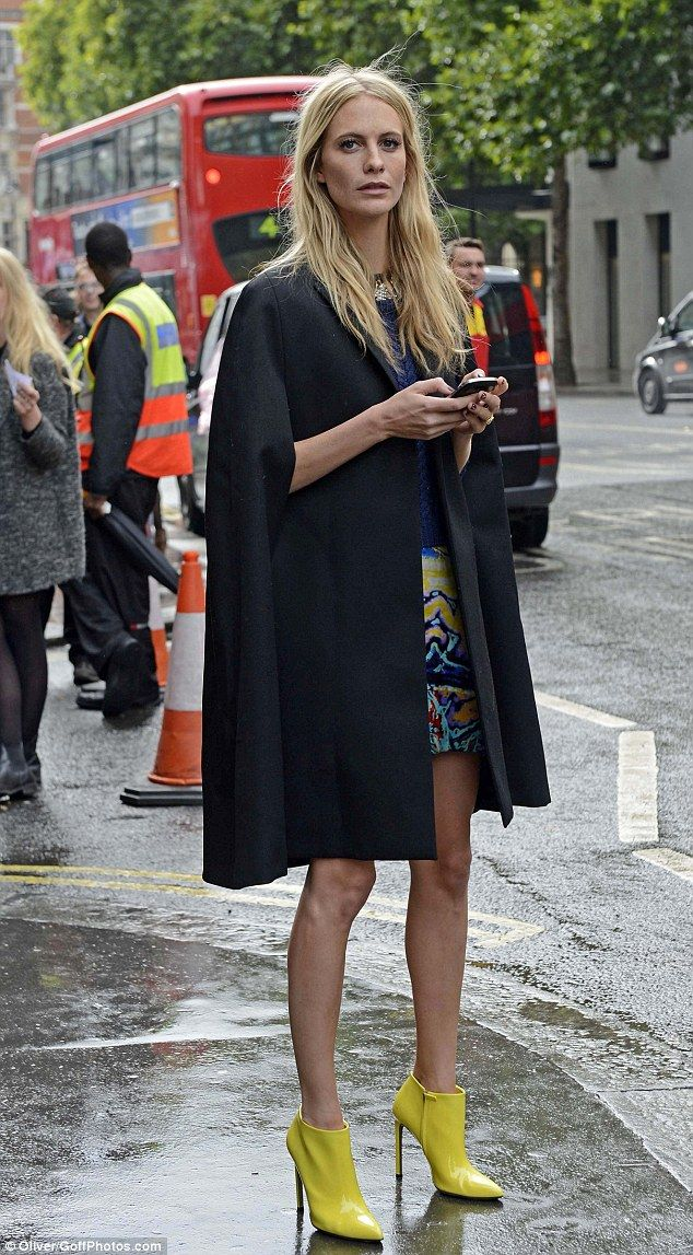 Cape, Poppy in London, she looks great in it. Mere mortals, without those pins, would look ridiculous