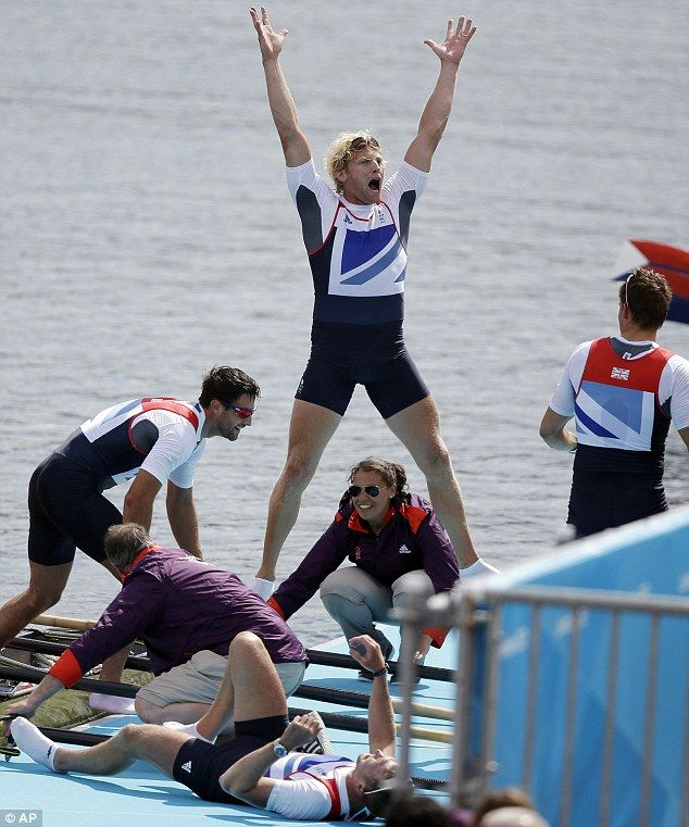 Glory: Andrew Triggs Hodge celebrates with arms aloft after he and team-mates Tom James, Pete Reed and Alex Gregory clinch gold in the men's rowing four event