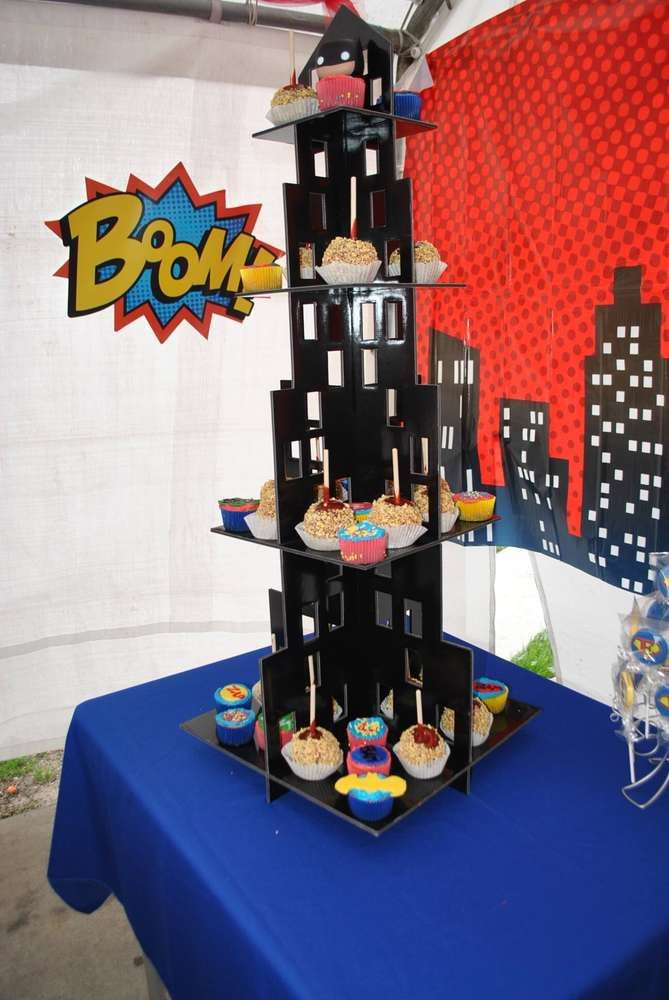Superhero  birthday party cupcake tower!  See more party planning ideas at CatchMyParty.com!