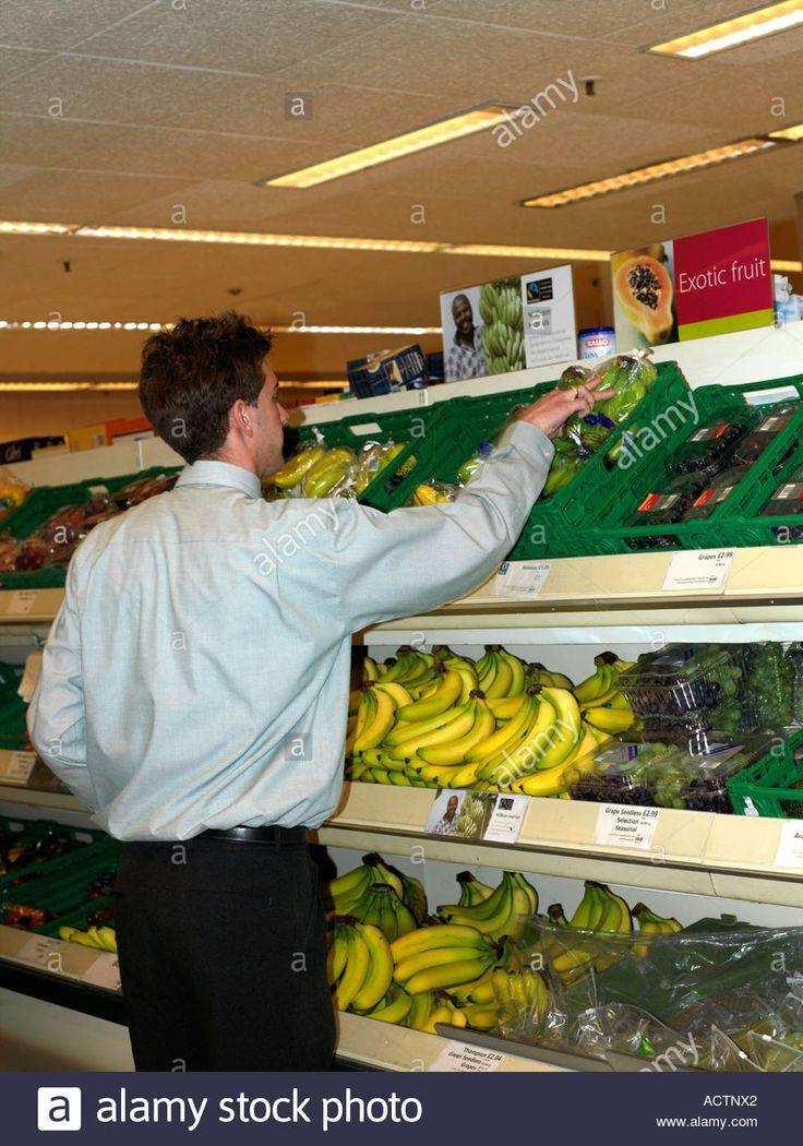 Stacking Fairtrade Bananas in Waitrose Supermarket Epsom Surrey England Stock Photo