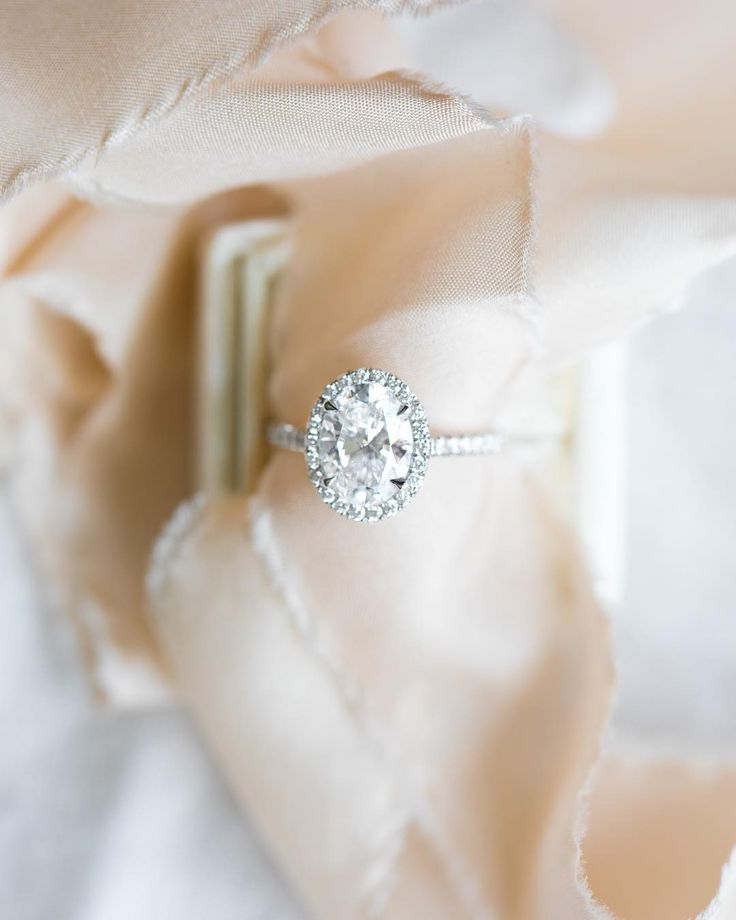 Sunday Oval halo engagement ring!  Made in white gold, yellow gold, or rose gold...