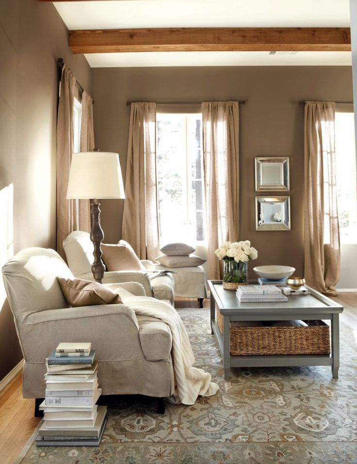 Burlap curtains blend in with the homey decor of this living room