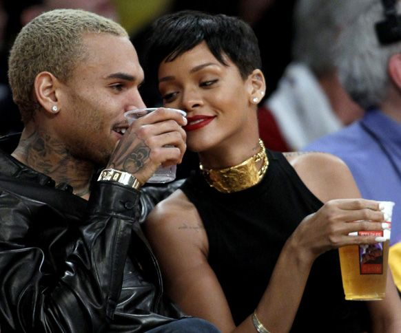 Entertainers #ChrisBrown, left, and #Rihanna attend an NBA basketball game between the Los Angeles Lakers and New York Knicks in Los Angeles.