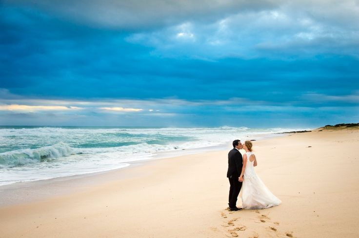 A beautiful shot of the Rye Back Beach and lovely couple by Chris Clinnick Photography. Eagle Ridge Wedding Venue, Mornington Peninsula