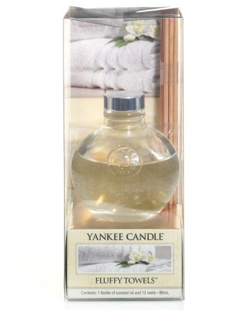 Fluffy Towels - The fresh scent of clean towels warm from the dryer with notes of lemon, apple, lavender and lily.   Combine beautiful Yankee fragrance with stylish motifs and hassle-free aroma. Each reed diffuser features a lovely design and looks great in any room. The patterned bottle contains fragrance oils that are gradually drawn up through the reeds and diffused into the air. This gives you the perfect level of continuous, effort-free fragrance for up to 6-8 weeks. Simple!