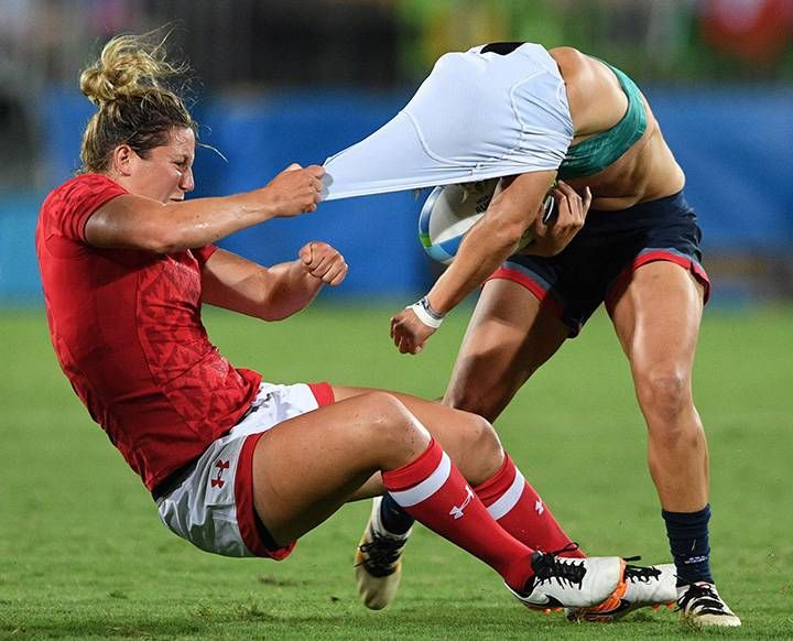 Canada's Kelly Russell rips the shirt off of Great Britain's Katy McLean as she tackles her during the bronze medal match in women's rugby sevens at the 2016 Olympic Summer Games in Rio de Janeiro, Brazil on Aug. 8, 2016.