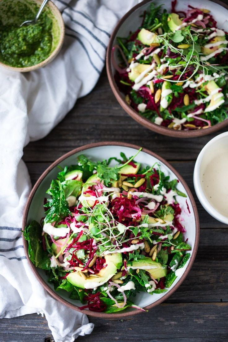 VEGAN POWER SALAD- This Beet and Avocado Salad with Cashew Tahini Dressing, power greens, cashew basil pesto, quick pickled shallots and toasted pumpkin seeds is the BEST! | http://www.feasingathome.com