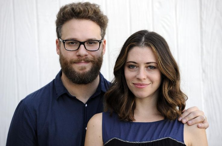 Actors/writers Seth Rogen and his wife Lauren Miller Rogen pose together for a…