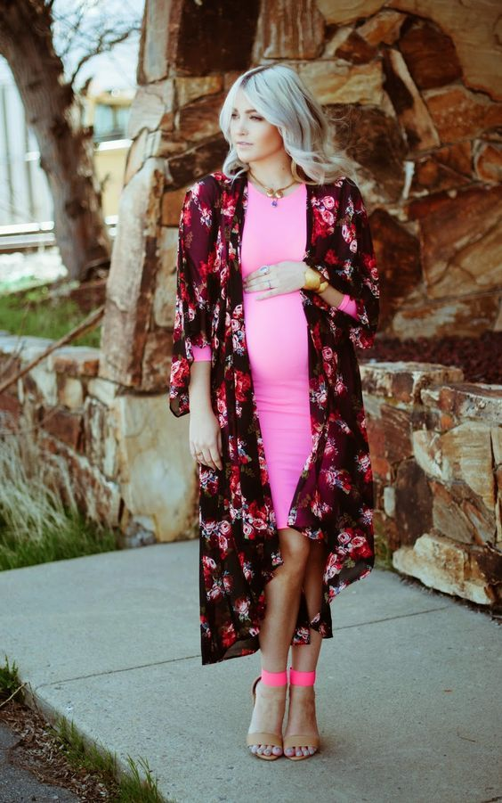 pink maternity dress with a floral cover