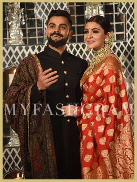 468e35153e1799 Anushka Sharma in red Sabyasachi banarasi saree and Virat Kohli in black  sabyasachi bandhagala