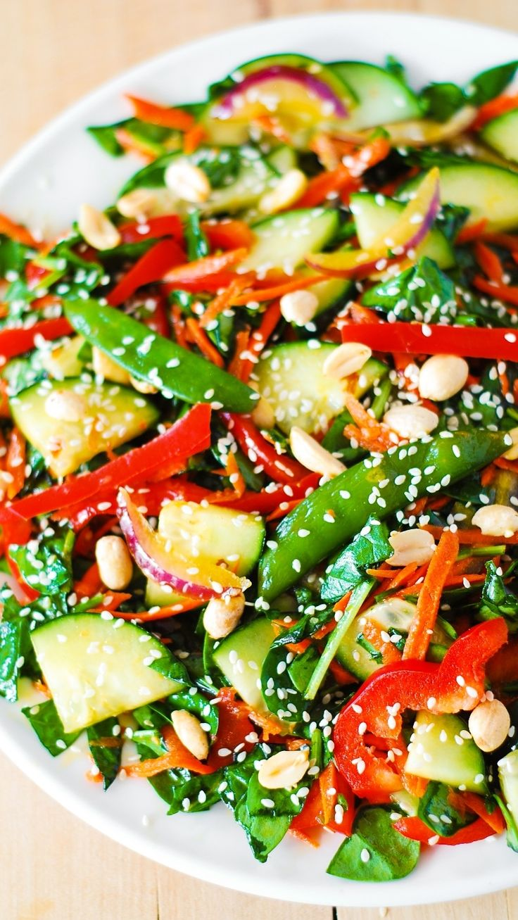 Crunchy Asian salad with peanut dressing. Vegetables tossed in a delicious, homemade peanut dressing, and topped with toasted peanuts and sesame seeds. The salad dressing is both sweet and sour, and very creamy! #gluten_free #vegetarian #salad