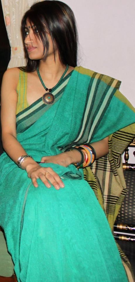 Handloom Green Saree with Sleeveless Blouse