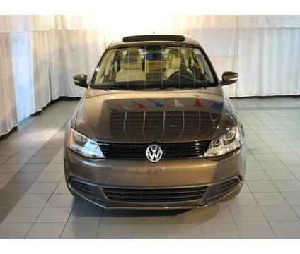 2012 VW Jetta 2.5 SE with Sunroof and Conv. Toffee Metallic. My ride.