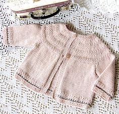 Ravelry: Baby jacket with round yoke and Moss stitch trim P033 by OGE Knitwear Designs