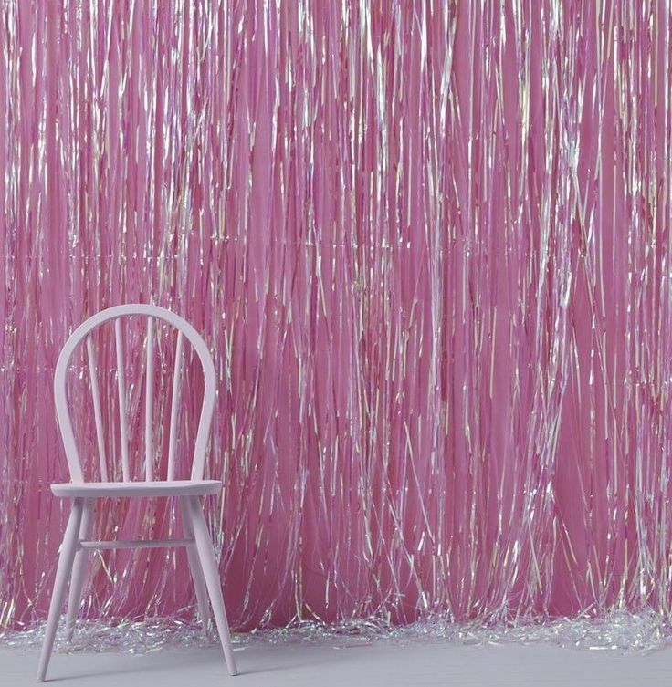 Celebrate in style by hanging this stunning Iridescent Fringe Curtain at your next party The iridescent foil shimmers and shines to create a rainbow