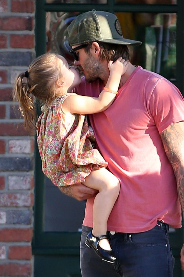 First Harper gives Daddy David a kiss and our hearts melt a little bit. | These Pictures Of Harper Kissing David Beckham Are The Cutest