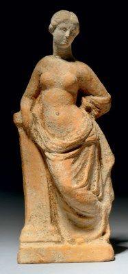 A GREEK TERRACOTTA APHRODITE TANAGRA, CIRCA LATE 4TH-3RD CENTURY B.C.